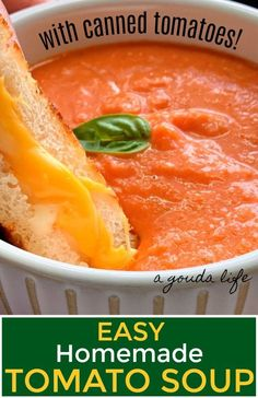 Easy Homemade CREAMY Tomato Soup from CANNED TOMATOES, fresh herbs and cream in under 30 minutes. Simple, comforting lunch or dinner – perfect for dunking! #tomatoes #tomatosoup #soup #homemadesoup #homemadetomatosoup #creamoftomatosoup #agoudalife