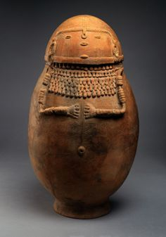 """Female-effigy ceramic burial urn, Northern Andes, Columbia, South America, 1,000–1,500 AD. 23 x 40"""" in circumference"""