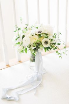 gorgeous white bouquet featuring peonies, garden roses, ranunculus and anemones by Hey Gorgeous Events