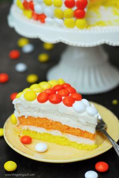 A Candy Corn Layer Cake is sure to impress everyone at your Halloween Party. It is easy to make and is covered with candy corn M&M's!