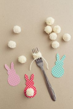 This colorful Easter garland is so easy to make with scrapbook paper and yarn! Both kids and adults will love making this together.
