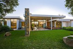 TT Architecture | Hodak House Canberra I love this stone feature wall!!