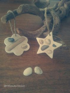 Use a cookie cutter to make the shapes you like and cut them out of some Do&Dry form Creall. Then push some seashells in it and let it dry till. When they are done your can spray some glue on top and dip them into some sand to finish it off.