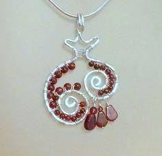 Open Pomegranate sterling silver and garnet pendant..  via Etsy.