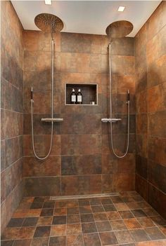 Love the double shower. Showerheads as big as dinner plates. Wouldnt have those tiles though..