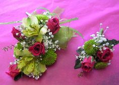 wrist corsage and bout with pink sweetheart roses, kermits, and alstro