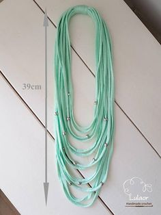 Handmade multi strand necklace. Made of high quality mint t-shirt yarn (cotton fabric) and acrylic silver beads. This beautiful necklace will jazz up any plane outfit. If youd like this necklace in a different color or size, please feel free to contact me and I will gladly make one for you.