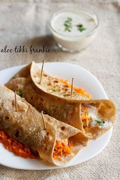 aloo tikki frankie/wrap recipe - thin rotis stuffed with crisp aloo tikki, veggies and yogurt raita. step by step recipe.