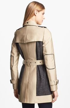 Double Breasted Wool Inset Trench Coat in tan by Sam Edelman $196 - $131 on sale at Nordstrom. [Back] An iconic khaki trench detailed with quilted gunflaps and elbow patches gets a mixed-media update from tweed side panels. Epaulets. Removable belt. Front button-flap pockets. Belted cuffs. Pleated storm flap. Water resistant. Lined. Cotton/polyester/nylon; dry clean. True to size. S=4-6, M=8-10