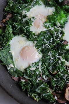 Fried Eggs with Kale and Mushrooms - olive oil, chopped kale, onion, mushrooms, minced garlic (optional), salt & pepper, eggs, grated cheddar cheese, salsa (for serving), potatoes (for serving, would omit or sub sweet potatoes)