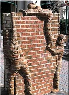 Some kids climbing a brick wall...#Sculpture
