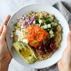 Mediterranean Quinoa Bowls with Roasted Red Pepper Sauce! A mix of quinoa, cucumbers or kale or spinach, feta cheese, kalamata olives, and pepperoncini!   pinchofyum.com