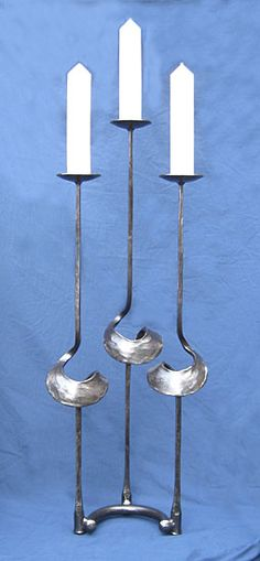 candlestick in metal, made by blacksmith