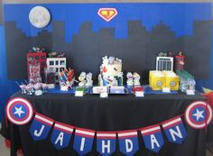 Superhero dessert table with Denver's Skyline