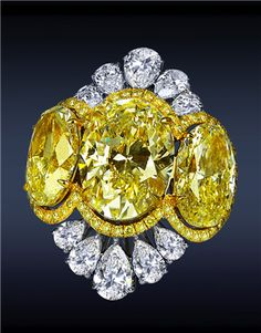 Jacob & Co.Diamond Cocktail Ring, 32.18cts Yellow Oval Cut Diamonds, Surrounded by Pave Set Yellow Diamonds, 5.59cts Pear Shape Diamonds, Higlighted with 3.06cts Pave Set White Diamonds on Shank.
