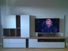 NAT living combination 503. In matt white lacquer and walnut. 280cm TV stand with TV panel and wall hung unit on the right. Delivered to our client in London.