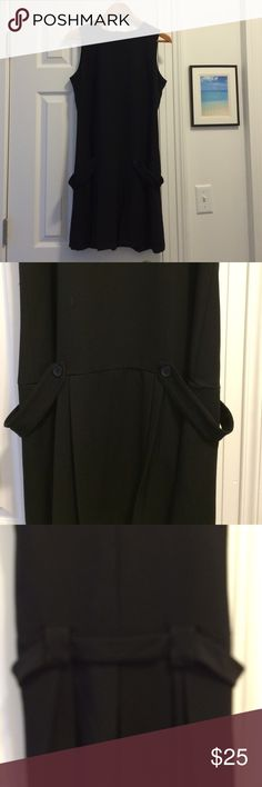 Sleeveless belted little black dress LBD Sleeveless little black dress by an'ge. Worn once. Seriously. Belt (for decoration only) goes around the back and then ends on each side being buttoned in (see pics 2 and 3). Zips up in the back. The tag is confusing me. It says size 2. Maybe it's from another country? I am not, nor have I ever been a size 2 so I'm calling it a medium. Matches almost exactly size wise to a similar Necessary Objects black dress in medium. 62%polyester, 33% viscose, 5%…