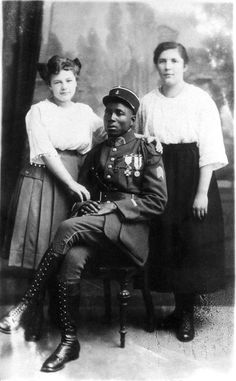 """Colonial soldier with German women 1919. In the period following World War I French colonial troops were used as part of the Allied occupation of the German Rhineland in accordance with the Treaty of Versailles. Germ Hitler wrote about the Black Shame in Mein Kampf decrying the """"negrification"""" of Europe. His government would later sterilize 500 or so mixed-race children born of African servicemen and German women (the so-called """"Rhineland Bastards"""")"""