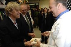 Rock star Bob Geldof tours Albensi lab during his visit to Winnipeg for acceptance of Humanitarian Award