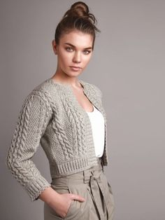A fitted cropped length, long sleeved, open front cardigan with cables, rib & moss stitches and scalloped edge... See our great prices and fast service.