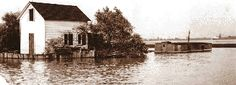 This fisherman's house at the lower end of Mud Island in the Detroit River and the partially submerged boathouse at right were a terminal for an underwater cable system that carried illegal booze along the river bottom.