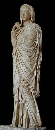 """Fringed palla. """"...respectable women also wore a long cloak, called a palla, over their tunic and stola when they went outside. This was rectangular in shape and was typically draped over the left shoulder, under the right arm and back across the body, carried by the left arm or thrown back again over the left shoulder. The palla could also be pulled up to cover the head, as shown in the above statue of Livia or in this depiction of a matron whose elegantly draped palla has a fringe.""""…"""
