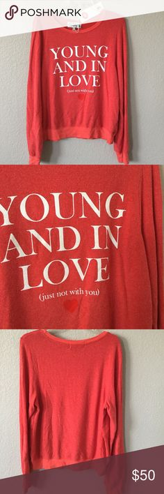 "Wildfox ""Young and in Love"" red pullover Great Wildfox pullover, soooo sooooft and cute!  Typical of the brand, will fit slightly roomy on a M.  Bust 44"", length 26"".  NWT! Wildfox Tops Sweatshirts & Hoodies"