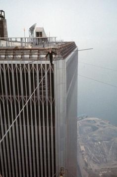 Philippe Petit takes his first steps over swaying rope with help of balance pole.