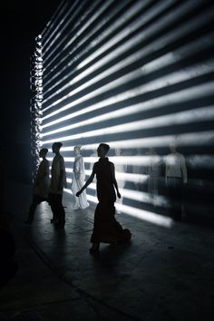 www.joyce.com I Special Feature I Inside the World of Rick Owens -- the horizontal lighting creates a type of barrier, maybe between two worlds, or freedom, its very powerful especially with the smoke and actors walking through it. More