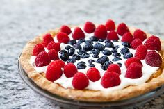 Classic American buttermilk pie, fancied up a bit with red, white, and blue (raspberries, whipped cream, and blueberries).