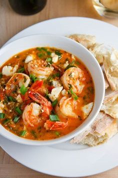 Tourkolimano ~ Greek shrimp cooked in a tomato, garlic, herbs and wine sauce that is finished off with feta cheese.Garides Tourkolimano ~ Greek shrimp cooked in a tomato, garlic, herbs and wine sauce that is finished off with feta cheese. Shrimp Dishes, Shrimp Recipes, Fish Recipes, Soup Recipes, Cooking Recipes, Healthy Recipes, Shrimp Soup, Greek Food Recipes, Cooked Shrimp