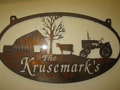Rustic, personalized metal sign with old barn and cow and tractor scene . Measures 32 x 17.7. Powder coated black or beautiful rustic bronzed