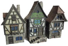 Timber-frame facades from Stronghold Terrain (painted by cianty) Fantasy Town, Medieval Fantasy, Medieval Houses, Medieval Town, Minecraft Medieval, Minecraft Houses, Miniature Crafts, Miniature Houses, Fire London