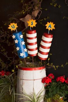 Patriotic metal firecracker yard stake. Great for your 4th of July celebration decorations or everyday Americana garden decor.