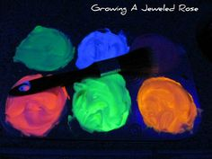 Use neon food coloring, shaving cream and a black light to create Glowing Homemade Bath Paint!