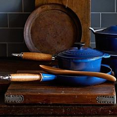Le Creuset Heritage Cast Iron Saucepan...LOVE this blue version with the rustic wooden handles...as well as the other vintage pieces in this picture.