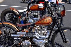 A pair of Triumph bobbers nicely turned out. 1954 Triumph T100 in front and a 1964 Triumph TR6 in back