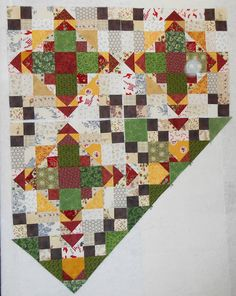 Alternative colors for Bonnie Hunter's Easy Street Mystery quilt - the green pieces make up the dominate coloring of the quilt