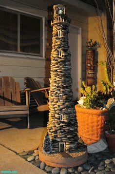 5 ft tall beach pebble lighthouse with a large solar light on top - Brian McStotts Garden Lighthouse, Clay Pot Lighthouse, Lighthouse Decor, Garden Crafts, Garden Projects, Garden Art, Deck Design, Garden Design, Solar House Numbers