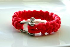 Red paracord bracelet.