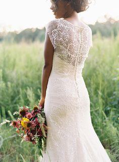 Gorgeous backless wedding dress with unique lace detail!