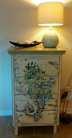 Seahorse art dresser makeover by Beachy Keen: https://www.facebook.com/beachykeenbiloxi/photos/pb.633905706700639.-2207520000.1409427621./647750985316111/?type=3&theater