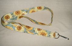 Sunflowers 3 blue handmade fabric lanyard by doodlebugquilts (Accessories, Lanyard, Id, keychain, id, fabric, handmade, women, colorful, summer, sunflower, gold, brown, flower, white, blue)