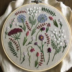 """Finished this 8"""" wildflower hoop that I've been working on for the last week it's been my favorite to make ✂️"""