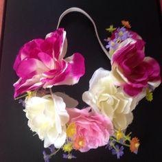 💎NWOT💎 Asos Flower Crown Multiple colored flower crown. Elastic headband. Never worn. Brand new. ⚡️PRICE IS FIRM UNLESS BUNDLED⚡️ ASOS Accessories Hair Accessories