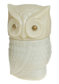 Vintage cream colored glass owl bottle: I have two of these. One on a nightstand in my bedroom and one in my entrance way. I paid $3 for both (antique shop). Modcloth is selling one for $13!