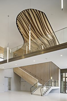 Uniquely shaped wooden ceiling. By Brenac Gonzalez Associates. #office #officedesign #interiordesign #interiors