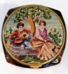 Vintage Amber Bakelite Powder Compact with Micro Petit Point Courting Scene Lid.