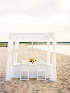 An intimate tented table for two: http://www.stylemepretty.com/michigan-weddings/2015/02/11/secret-beach-wedding-inspiration-at-sleeping-bear-dunes/ | Photography: Lauren Kinsey - http://laurenkinsey.com/