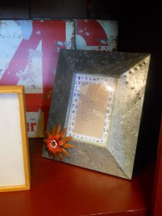 Metal Picture Frame. Can put magnets on it. Industrial